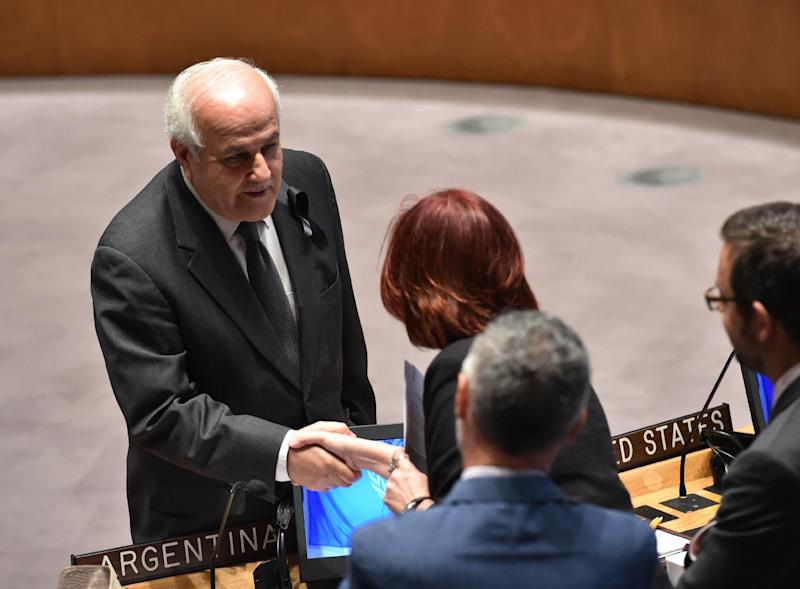 Riyad Mansour, Palestinian representative to the UN, shakes hands with other delegates before a Security Council meeting on the situation in Gaza, on July 22, 2014 (AFP Photo/Stan Honda)