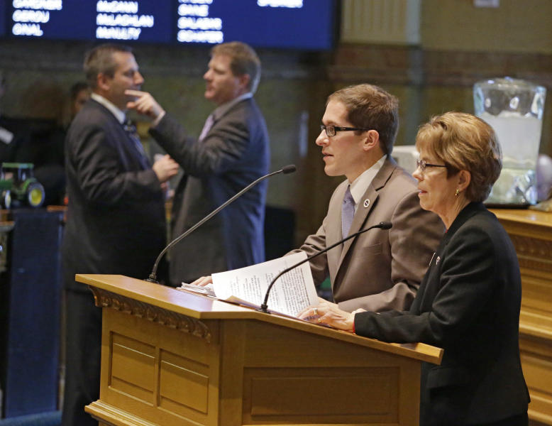 House Speaker Mark Ferrandino, second from right, and Rep. Sue Schafer, D-Thornton, share the podium as they speak on the Civil Unions Bill in the House Chamber at the Capitol on Monday, March 11, 2013. House Minority leader Mark Waller, R-Colorado Springs and Rep. Brian DelGrosso, R-Loveland, talk in the background. The proposal got initial approval with a voice vote in the Democratic-controlled House on Monday. (AP Photo/Ed Andrieski)