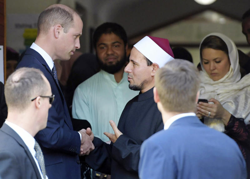 Britain's Prince William, top left, is farewelled by Imam Gamal Fouda after his visit to the Al Noor mosque in Christchurch, New Zealand, Friday, April 26, 2019. Prince William visited the one of the mosques where 50 people were killed and 50 others wounded in a March 15 attack by a white supremacist. (Tracey Nearmy/Pool via AP)