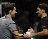 Switzerland's Roger Federer, right, shakes hands with Austria's Dominic Thiem after he lost the match against Thiem during their ATP World Tour Finals singles tennis match at the O2 Arena in London, Sunday, Nov. 10, 2019. (AP Photo/Alastair Grant)