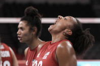 Haleigh Washington, of the United States, shouts in celebration of her team's 3-2 victory over Turkey, at the end of a women's volleyball preliminary round pool B match, at the 2020 Summer Olympics, early Friday, July 30, 2021, in Tokyo, Japan. (AP Photo/Manu Fernandez)