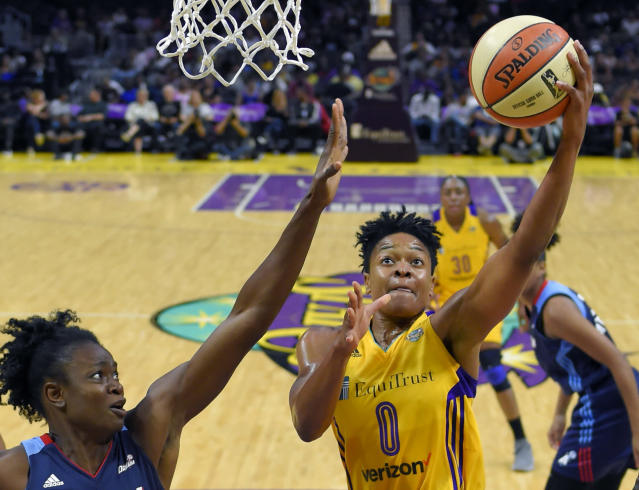 FILE - In this Sept. 1, 2017, file photo, Los Angeles Sparks guard Alana Beard, right, shoots as Atlanta Dream forward Aneika Henry-Morello defends during the first half of a WNBA basketball game in Los Angeles. Alana Beard, a two-time Defensive Player of the Year who won a WNBA championship with the Los Angeles Sparks, is retiring after 15 years. The Sparks announced her decision on Thursday, Jan. 23, 2020.(AP Photo/Mark J. Terrill, File)