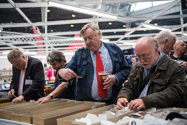 <p>Beer mat collectors browse mats for sale at the CAMRA (Campaign for Real Ale) Great British Beer festival at Olympia exhibition center on August 8, 2017 in London, England. (Photo: Carl Court/Getty Images) </p>