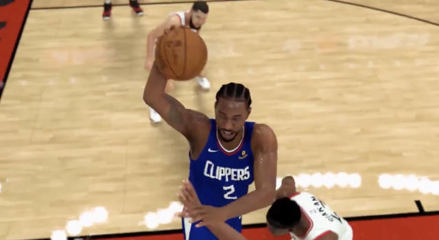 Kawhi Leonard, in his new Los Angeles Clippers jersey, takes it to the rim against the Toronto Raptors during the gameplay trailer for NBA 2K20. (Twitter//@NBA2K)