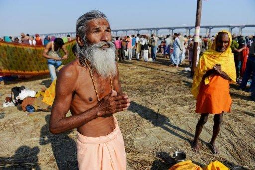 <p>A Hindu devotee prays on the banks of the Ganges river at the Kumbh Mela in Allahabad, on February 9, 2013. Tens of millions of Hindu pilgrims are preparing to cleanse their sins with a plunge into the sacred River Ganges, ahead of the most auspicious day of the world's largest religious festival.</p>