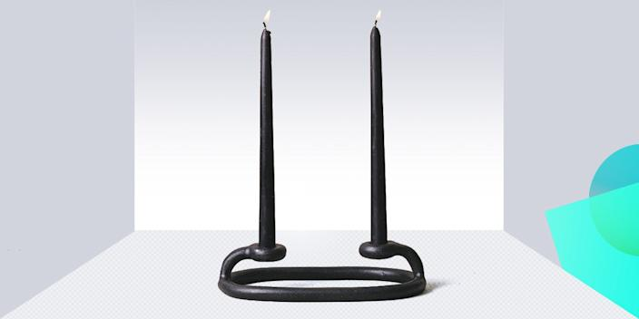 """<div class=""""caption""""> We call Sin's Duo Candlestick an artistic centerpiece that will never go out of style. Even better, the minimal, light-as-air design won't block your view across the table. <a href=""""https://virginiasin.com/collections/tabletop/products/duo-candlestick"""" rel=""""nofollow noopener"""" target=""""_blank"""" data-ylk=""""slk:SHOP NOW"""" class=""""link rapid-noclick-resp"""">SHOP NOW</a>: Duo Candlestick by Sin, $58, virginiasin.com </div> <cite class=""""credit"""">Photo courtesy of Sin</cite>"""