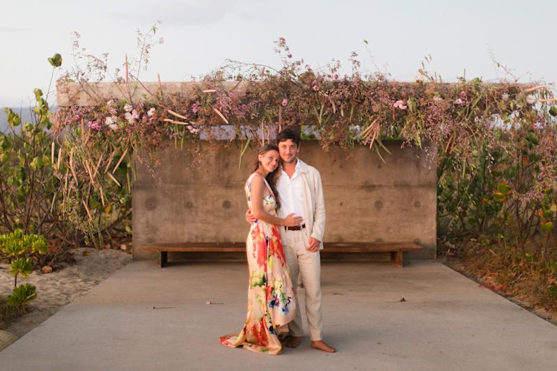 Us right after the ceremony; we ended standing under the Tadao Ando structure where we were wed. The flower sculpture above us was created by Fox Fodder Farm.