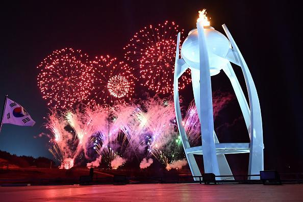 Fireworks explode behind the Olympic flame during the Closing Ceremony of the PyeongChang 2018 Winter Olympic Games at PyeongChang Olympic Stadium on Feb. 25, 2018 in Pyeongchang-gun, South Korea. (Photo by Florien Choblet – Pool/Getty Images)