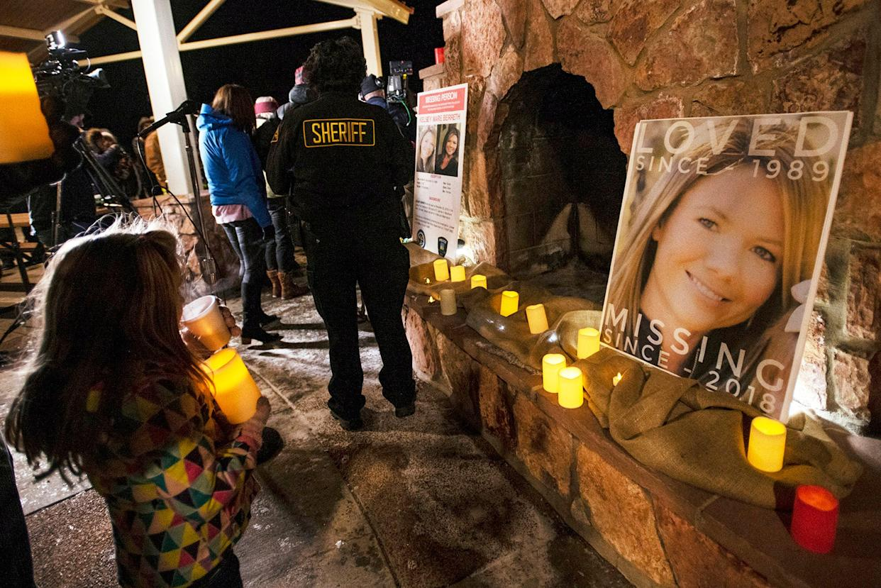 In this Dec. 13, 2018 file photo, community members hold a candlelight vigil for Kelsey Berreth under the gazebo of Memorial Park in Woodland Park, Colorado. Authorities say they arrested the fiance of the Colorado woman who was last seen on Thanksgiving. Teller County sheriff's Cmdr. Greg Couch said Patrick Frazee was arrested Friday, Dec. 21, 2018, at his home in Florissant, Colorado.
