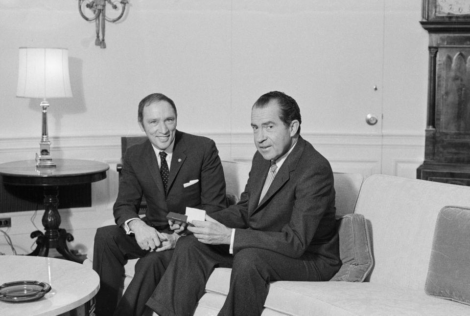 Archive photo of prime minister Pierre Trudeau and U.S. president Richard Nixon posing for picture on a sofa in the Chief Executive's office onMarch 24, 1969.