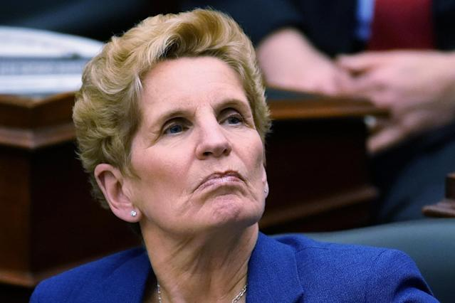 Ontario Premier Kathleen Wynne listens as Finance Minister Charles Sousa reads the new provincial budget at Queen's Park in Toronto, Ontario, Canada March 28, 2018. REUTERS/Carlo Allegri