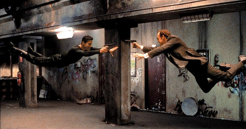 Neo (Keanu Reeves) and Agent Smith (Hugo Weaving) engage in some bullet time ballet in <em>The Matrix.</em> (Photo: Warner Bros./courtesy Everett Collection)