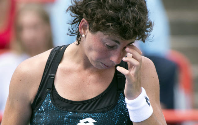Carla Suarez Navarro, of Spain, reacts as she faces Sloane Stephens, of the United States, during the Rogers Cup women's tennis tournament, Thursday Aug, 9, 2018 in Montreal. (Paul Chiasson/The Canadian Press via AP)