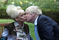 Britain's Prime Minister Boris Johnson kisses television actress Dame Barbara Windsor during a meeting in London on September 2, 2019 in London, England. Barbara Windsor, who suffers from Alzheimers, met with the Prime Minister at 10 Downing Street to discuss dementia care. (Simon Dawson - WPA Pool/Getty Images)