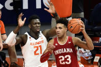 Indiana's forward Trayce Jackson-Davis (23) looks to pass as he is pressured by Illinois center Kofi Cockburn (21) in the first half of an NCAA college basketball game Saturday, Dec. 26, 2020, in Champaign, Ill. (AP Photo/Holly Hart)