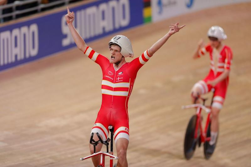 Denmarks Julius Johansen L and his teammates celebrate Gold and a new World Record in the mens Team Pursuit Finals at the UCI track cycling World Championship at the velodrome in Berlin on February 27 2020 Photo by Odd ANDERSEN AFP Photo by ODD ANDERSENAFP via Getty Images