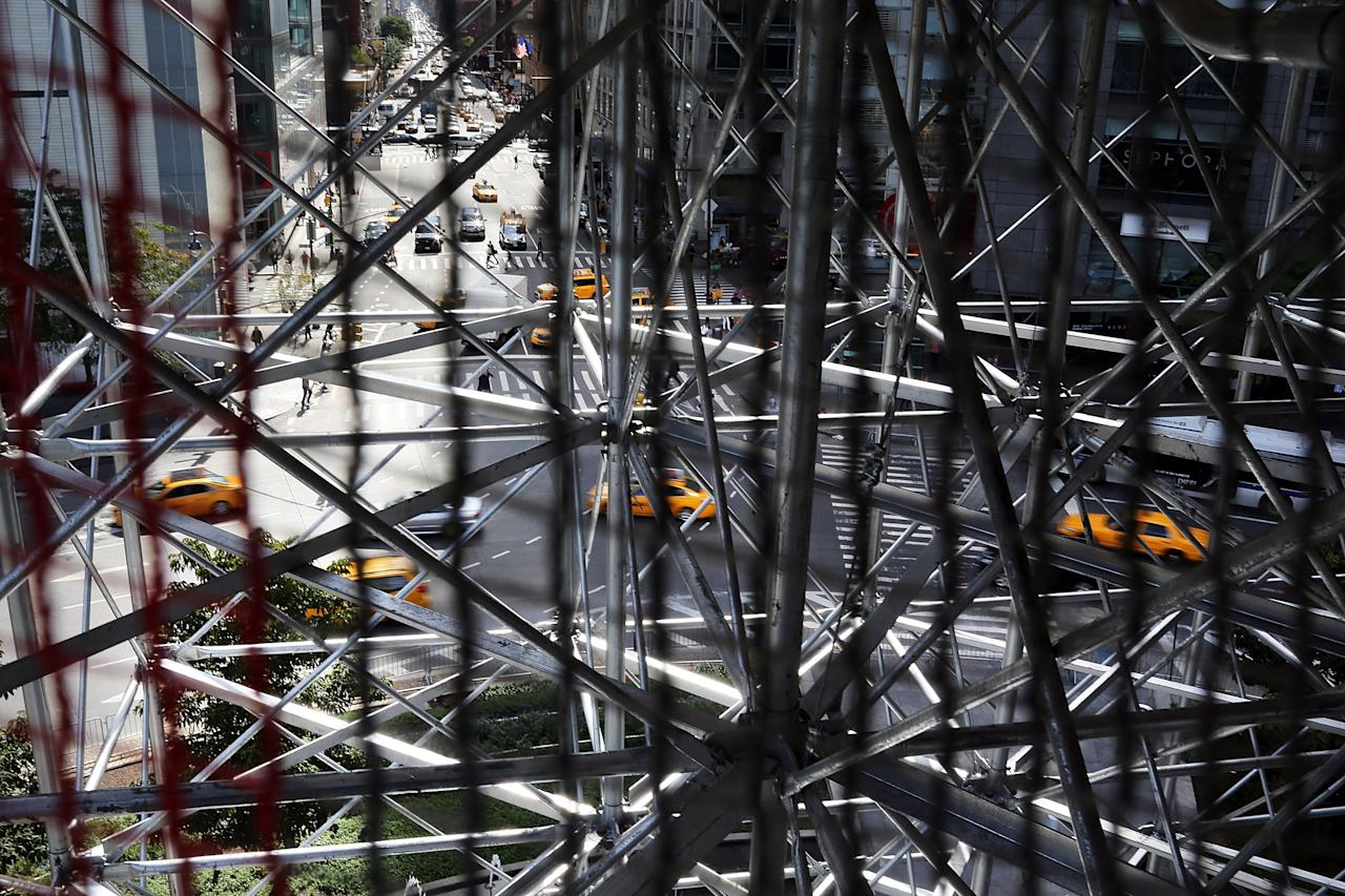 "NEW YORK, NY - SEPTEMBER 19:  Columbus Circle is viewed through the scaffolding of the  810-square-foot ""living room"" art installation by Japanese artist Tatzu Nishi which features the iconic 13-foot statue of Christopher Columbus on September 19, 2012 in New York City. Viewed as a piece of conceptual art, ""Living Room"", which sits 70-feet above ground level and is only accessible via a scaffold-encased staircase, has been temporarily built around the Columbus Monument in Columbus Circle. Beginning Thursday, up to 25 people at a time can enter the living room to view up close the 1892 marble figure of the Italian explorer.  (Photo by Spencer Platt/Getty Images)"