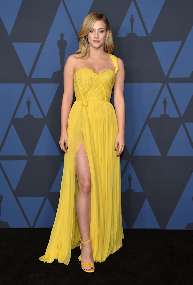 In the midst of fall, Lili brought summer sunshine to the red carpet. Appearing at the Academy Of Motion Picture Arts And Sciences' 11th Annual Governors Award, the star wore a completely yellow outfit. In addition to her single strap golden gown, she also wore matching heels. Her hair showed just a touch of waves, and she tucked a piece behind her ear to show off some diamond earrings.