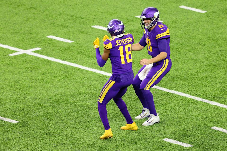 Kirk Cousins #8 and Justin Jefferson #18 of the Minnesota Vikings