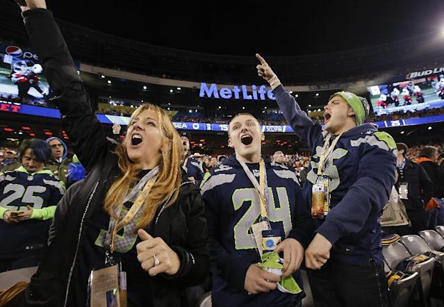 Seattle Seahawks fans cheer before the NFL Super Bowl XLVIII football game between the Seattle Seahawks and the Denver Broncos Sunday, Feb. 2, 2014, in East Rutherford, N.J. (AP Photo/Kathy Willens)