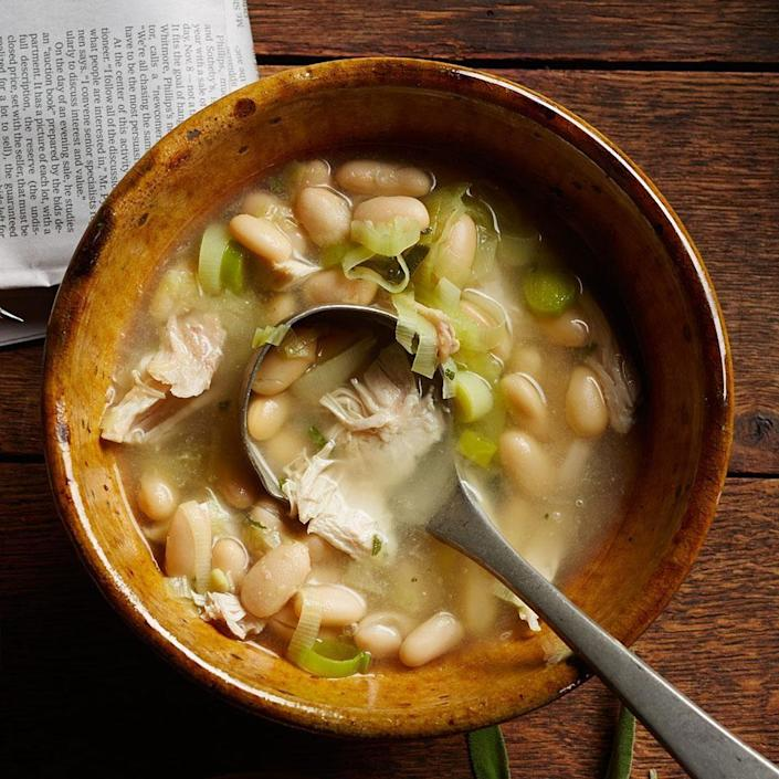 """<p>Once again, rotisserie chickens can really relieve the dinner-rush pressure-especially in this Italian-inspired soup that cries out for a piece of crusty bread and a glass of red wine. <a href=""""https://www.eatingwell.com/recipe/248881/chicken-white-bean-soup/"""" rel=""""nofollow noopener"""" target=""""_blank"""" data-ylk=""""slk:View Recipe"""" class=""""link rapid-noclick-resp"""">View Recipe</a></p>"""