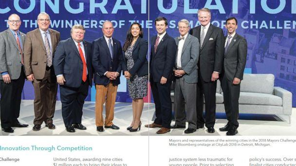 PHOTO: Michael Bloomberg appears in a photo with then-Mayor Pete Buttigieg and other mayors and city representatives in a photo from the Bloomberg Philanthropies 2019 Annual Report. (Bloomberg Philanthropies)