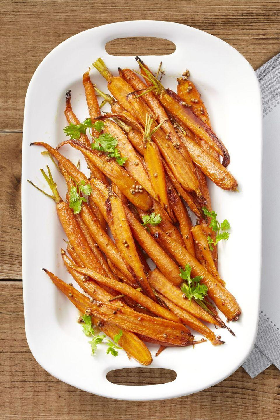 """<p>The sweet-and-savory combo of maple syrup and coriander seeds will even convert carrot-haters into craving this tasty recipe.</p><p><em><a href=""""https://www.womansday.com/food-recipes/food-drinks/a24115449/lemon-maple-roasted-carrots/"""" rel=""""nofollow noopener"""" target=""""_blank"""" data-ylk=""""slk:Get the recipe from Woman's Day »"""" class=""""link rapid-noclick-resp"""">Get the recipe from Woman's Day »</a></em><br></p>"""