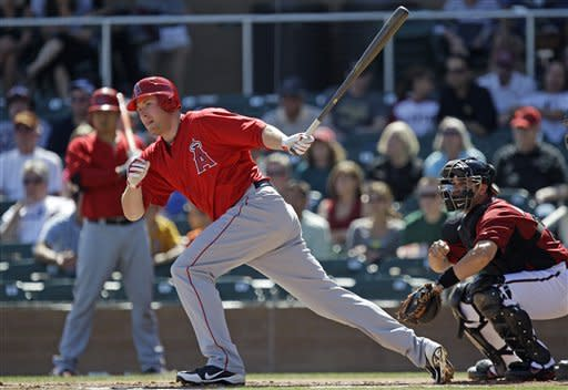 Los Angeles Angels' Mark Trumbo singles against the Arizona Diamondbacks during the first inning of a spring training baseball game Tuesday, March 13, 2012, in Scottsdale, Ariz. (AP Photo/Marcio Jose Sanchez)