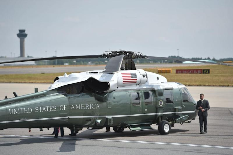 A US Marine Corps helicopter on the tarmac ahead of the the arrival of US President Trump and Melania Trump (PA)