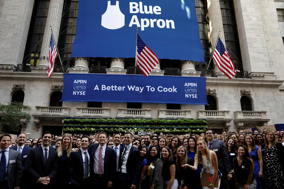 Blue Apron CEO Matthew B. Salzberg (C) poses with employees in front of the New York Stock Exchange before the company's IPO in New York, U.S., June 29, 2017.  REUTERS/Lucas Jackson