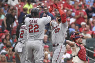 Minnesota Twins' Ryan Jeffers, right, is congratulated by teammate Miguel Sano, left, after hitting a three-run home run during the third inning of a baseball game against the St. Louis Cardinals on Saturday, July 31, 2021, in St. Louis. (AP Photo/Joe Puetz)