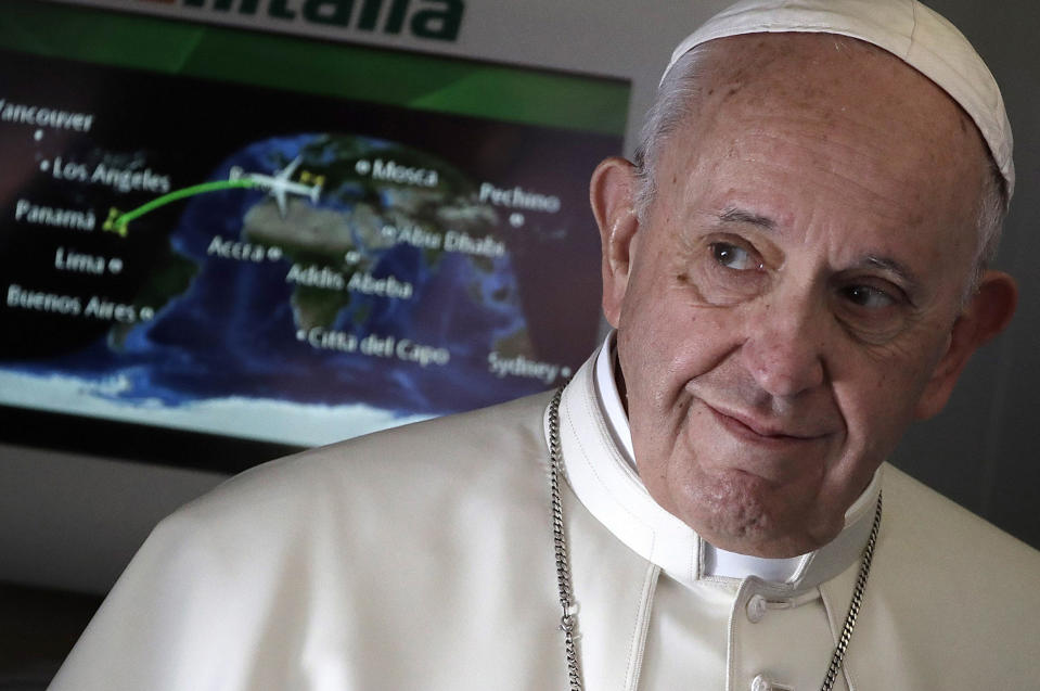 FILE - In this Jan. 23, 2019, file photo, Pope Francis arrives to talk to journalists during his flight from Rome to Panama City where he will attend the World Youth Day. Across the globe, Pope Francis' comments endorsing same-sex civil unions were received by some as encouragement for an advancing struggle and condemned by others as an earth-shaking departure from church doctrine. (AP Photo/Alessandra Tarantino, File)