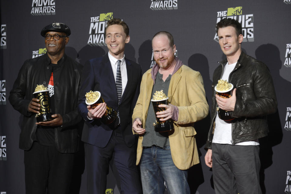 """Director Joss Whedon (2nd from R) and cast members Samuel L. Jackson (L), Tom Hiddleston and Chris Evans (R) pose with their awards for movie of the year for """"The Avengers"""" at the 2013 MTV Movie Awards in Culver City, California April 14, 2013.  REUTERS/Phil McCarten   (UNITED STATES  Tags: Entertainment) (MTV-BACKSTAGE)"""