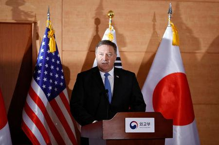 U.S. Secretary of State Mike Pompeo addresses a joint news conference alongside South Korean Foreign Minister Kang Kyung-wha and Japan's Foreign Minister Taro Kono at the Foreign Ministry in Seoul, South Korea June 14, 2018. REUTERS/Kim Hong-ji/Pool