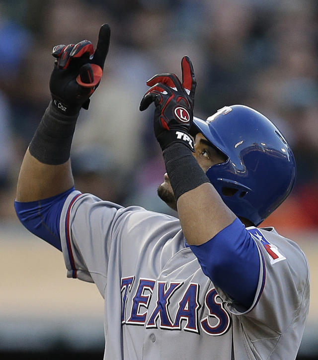 Texas Rangers' Nelson Cruz celebrates after hitting a two run home run off Oakland Athletics' Tommy Milone in the second inning of a baseball game, Friday, Aug. 2, 2013, in Oakland, Calif. (AP Photo/Ben Margot)