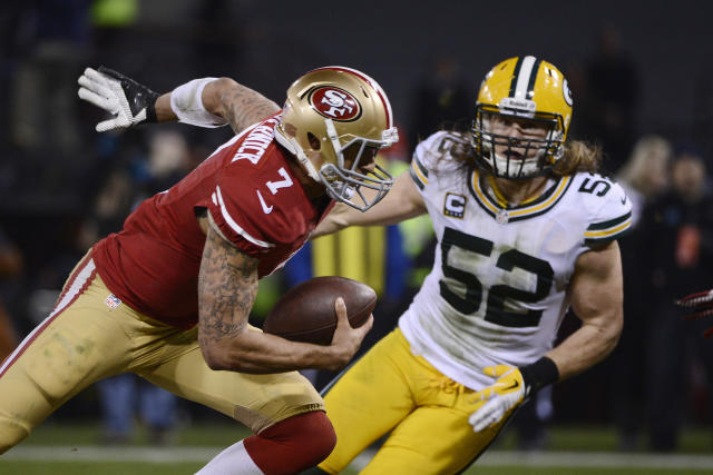 Colin Kaepernick carries the ball on his tattoo-covered right arm against the Packers. (USA Today Images).