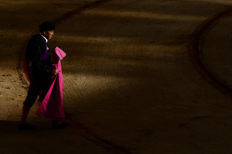 An unidentified Spanish bullfighter assistant performs during a bullfight at San Fermin Fiestas, in Pamplona, Saturday, July 7, 2012 in Pamplona, Spain. (AP Photo/Ivan Aguinaga)