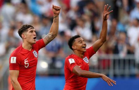 FILE PHOTO: Soccer Football - World Cup - Quarter Final - Sweden vs England - Samara Arena, Samara, Russia - July 7, 2018 England's John Stones and Jesse Lingard celebrate after the match REUTERS/Lee Smith TPX IMAGES OF THE DAY