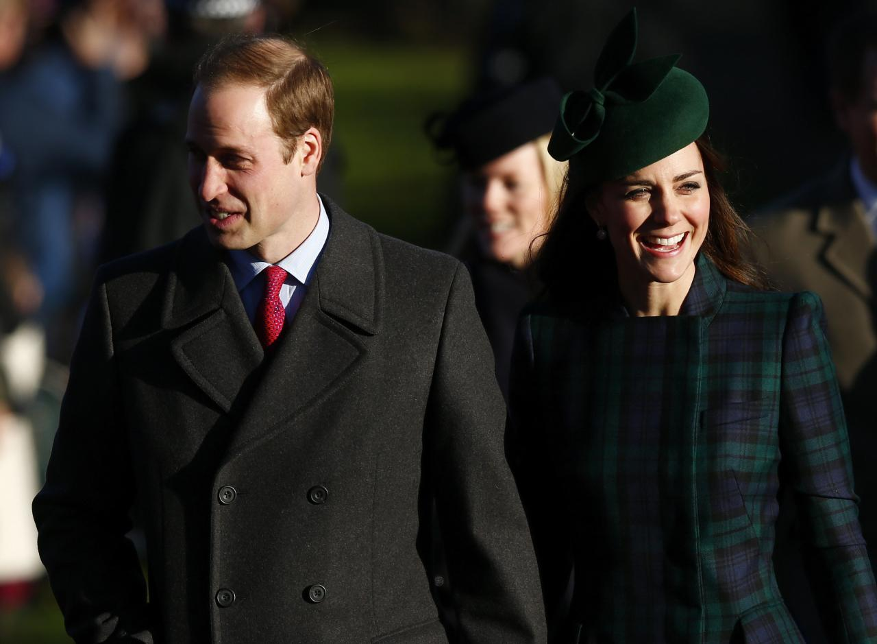 Britain's Prince William and Catherine, the Duchess of Cambridge, walk to a Christmas Day morning service at the church on the Sandringham Estate in Norfolk, eastern England, December 25, 2013. REUTERS/Andrew Winning (BRITAIN - Tags: ROYALS RELIGION)