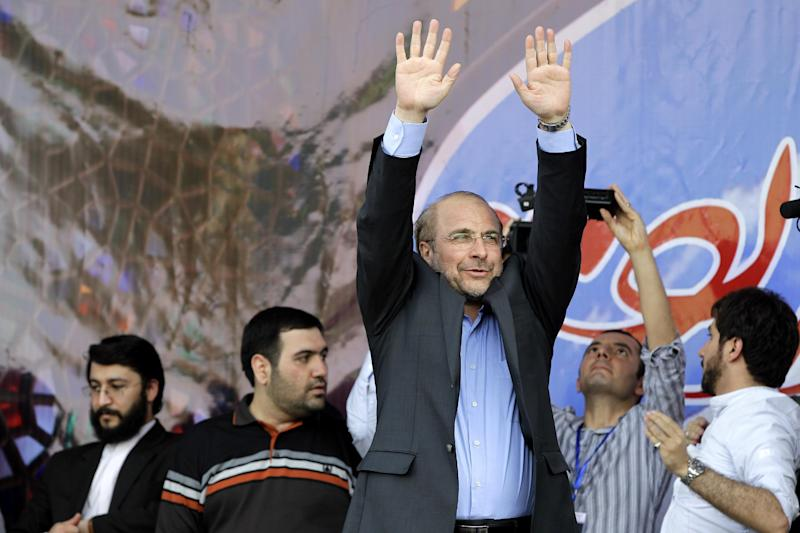 Iranian presidential candidate, Mohammad Bagher Qalibaf, who is also Tehran's mayor, waves to his supporters, during a campaign rally, in Tehran, Iran, Wednesday, June 12, 2013. The presidential election will be held on June 14. (AP Photo/Ebrahim Noroozi)