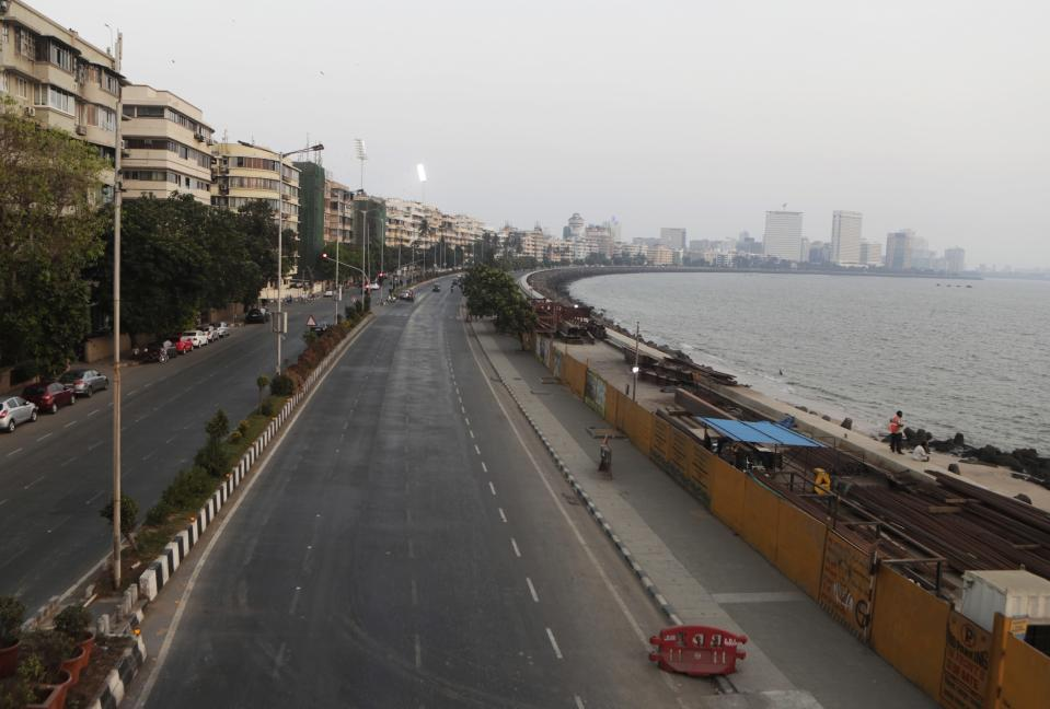 FILE - In this April 15, 2021, file photo, marine line wears a deserted look following restrictions in Mumbai, India. The picture is still grim in parts of Europe and Asia as variants of the virus fuel an increase in new cases and the worldwide death toll closes in on 3 million. (AP Photo/Rajanish Kakade, File)