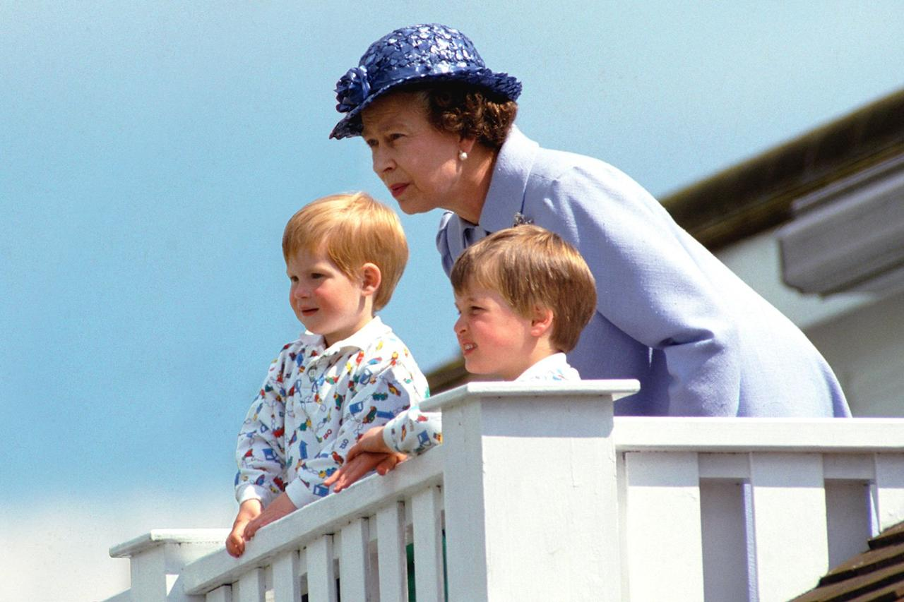 """The Queen, <a href=""""https://people.com/royals/prince-harry-prince-william-deny-reports-bullying/"""">Prince Harry and Prince William</a> in The Royal Box at Guards Polo Club in 1987."""