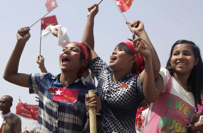 Supporters wave party flags of Myanmar pro-democracy leader Aung San Suu Kyi's National League for Democracy during her election campaign rally in Meikhtila, central Myanmar, Monday, March 5, 2012. (AP Photo/Khin Maung Win)