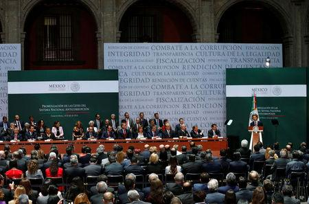 Mexico's President Enrique Pena Nieto gives a speech during the promulgation of the anti-corruption laws at the National Palace in Mexico City