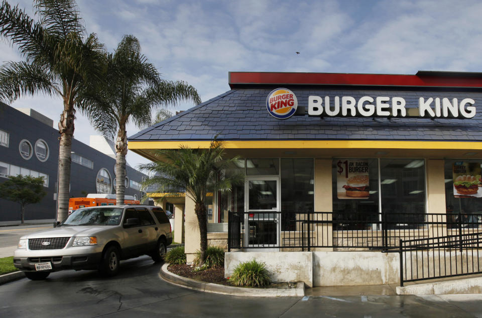 FILE - In this Thursday, April 25, 2013, file photo, a car stops at the drive-thru at a Burger King restaurant near downtown Los Angeles. Restaurant Brands reports financial results Thursday, Aug. 4, 2016. (AP Photo/Nick Ut, File)