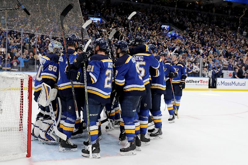 The St. Louis Blues celebrate after beating the San Jose Sharks 5-1 in game six of the NHL Western Conference final to reach the Stanley Cup final