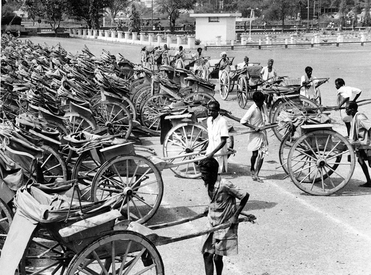 circa 1950: Men bringing in man-drawn rickshaws to be added to the large number of them stacked up in front of the Deputy Commioner of Traffic's office at Madras after a ban forbidding their use. They are to be replaced by cycle rickshaws, a combination of rickshaw and bicycle. (Photo by Keystone/Getty Images)