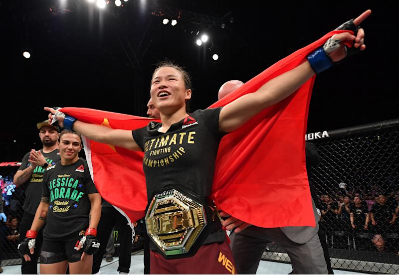 SHENZHEN, CHINA - AUGUST 31: Zhang Weili of China celebrates after her knockout victory over Jessica Andrade of Brazil in their UFC strawweight championship bout during the UFC Fight Night event at Shenzhen Universiade Sports Centre on August 31, 2019 in Shenzhen, China. (Photo by Brandon Magnus/Zuffa LLC/Zuffa LLC)