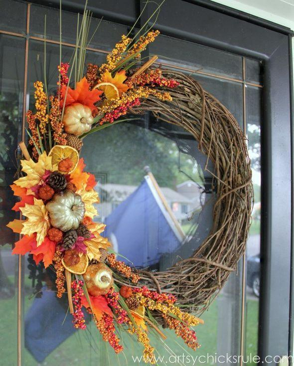 """<p>Believe it or not, you really can throw together this gorgeous wreath in just one afternoon. With the addition of dried flowers and fruit, it'll both look <em>and </em>smell good.</p><p><strong>Get the tutorial at <a href=""""https://www.artsychicksrule.com/diy-fall-wreath-fall-themed-tour/"""" rel=""""nofollow noopener"""" target=""""_blank"""" data-ylk=""""slk:Artsy Chicks Rule"""" class=""""link rapid-noclick-resp"""">Artsy Chicks Rule</a>.</strong> </p>"""