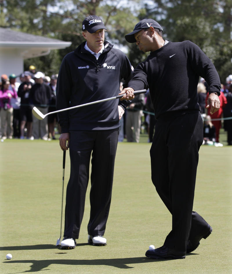Tiger Woods, right, chats with Steve Stricker on the practice green as they prepare for the Masters golf tournament Tuesday, April 5, 2011, in Augusta, Ga. (AP Photo/Chris O'Meara)
